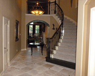 entry way with travertine flooring and staircase